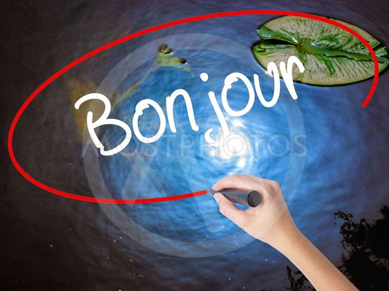 Woman Hand Writing Bonjour By Netsay Mostphotos