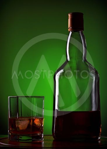 whiskey and glass on wooden tray