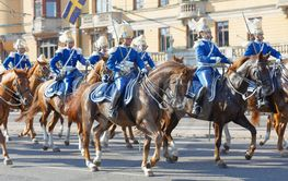 The Royal guards in blue uniforms on the horse back