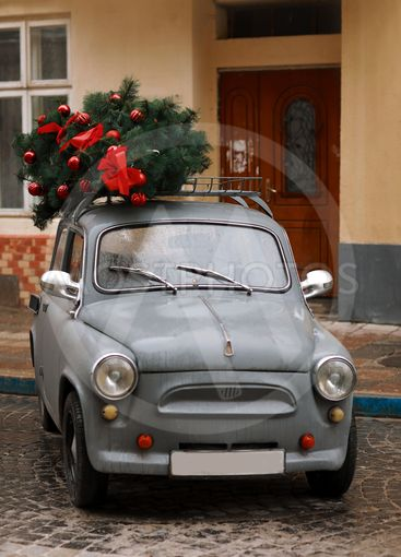 View of a red retro car with Christmas tree. Winter....