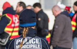 portrait on back view of municipal police woman looking...