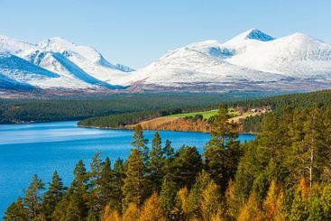 Lake in front of snowcapped mountain landscape, Norway.