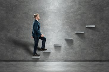 A man climbs up the career ladder. The concept of...
