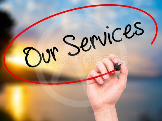 Man Hand writing Our Services with black marker on visual...