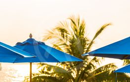 umbrella around swimming pool in hotel and resort neary...