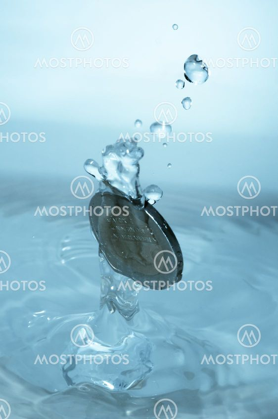 Coin falling in water