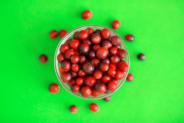 Fresh red cranberries in a glass bowl