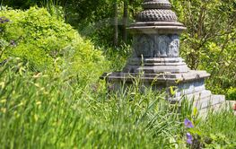 Asian temple like a stupa in the garden. Asiatic...