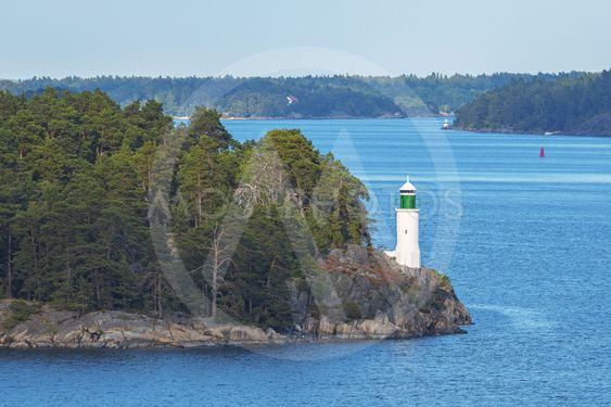 White beacon at coastline in the swedish archipelago...