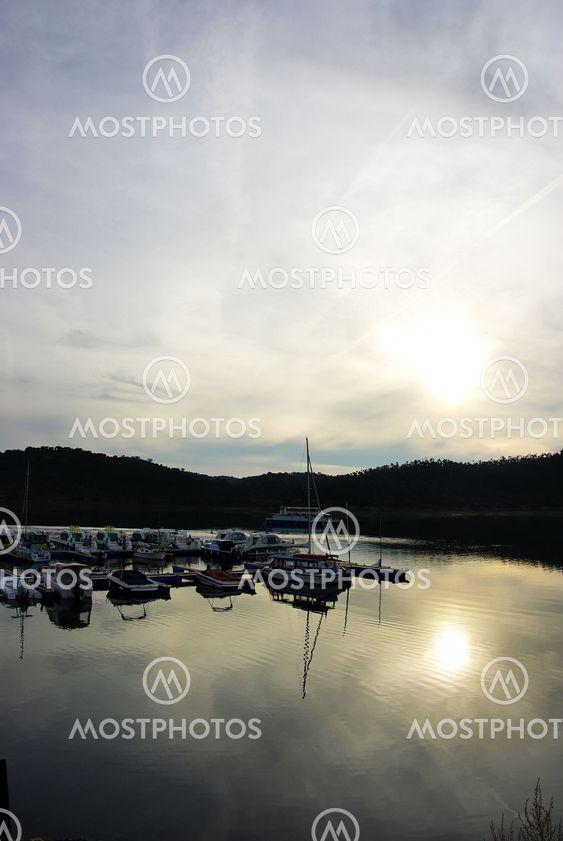 Boats on marina bay at sunset