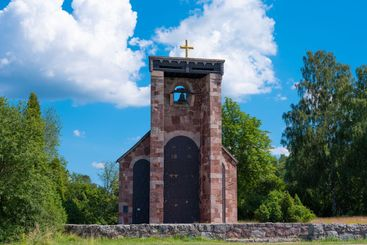 Countryside chapel with stone wall