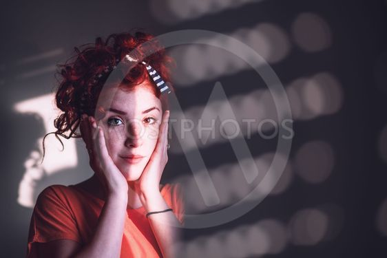 Young woman looking worried by the window