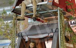 Woman and kid testing camp tent in annual exhibition of...