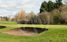 A Beautiful Golf Green And Two Sand Bunkers On A Sunny...