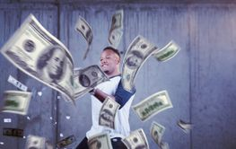 black businessman making the rain of money