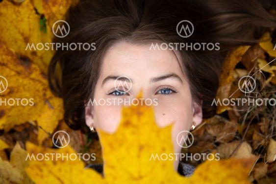 Top view of a cute girl with blue eyes, which in the...