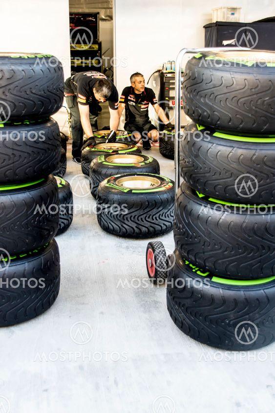 Scuderia Toro Rosso. Mechanics. Checking the tyres before...