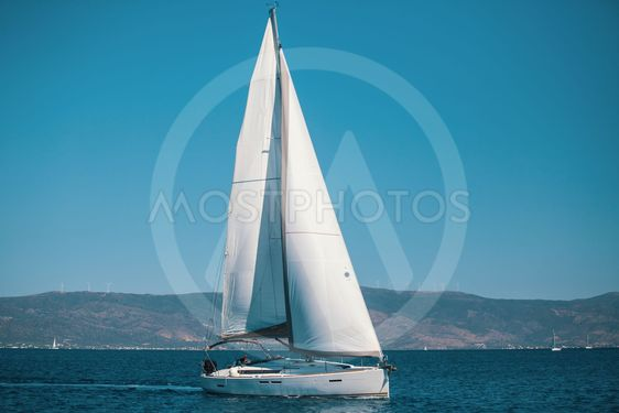Sailing ship luxury yacht with white sails in the Aegean...