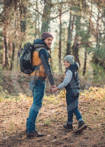 father and son hiking together