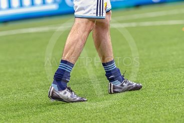 Soccer players legs and shoes during warmup between DIF...