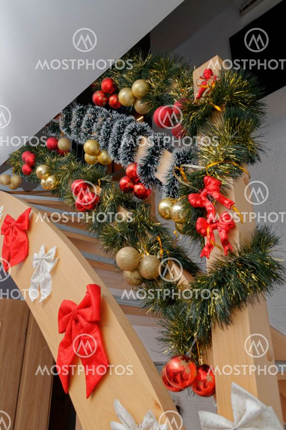 stairs in the house decorated for the holidays