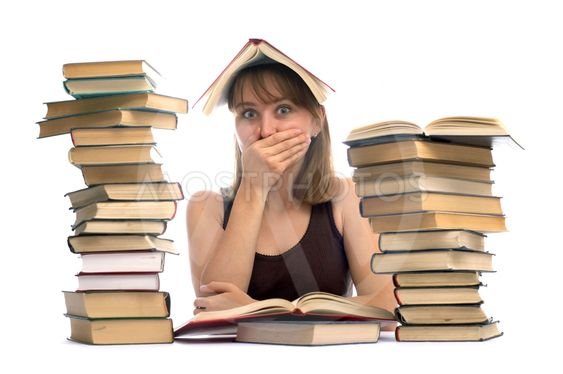 The young woman and a pile of books