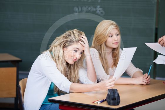 Dissatisfied Female Student Looking At Question Paper In...