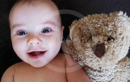 baby and teddy bear