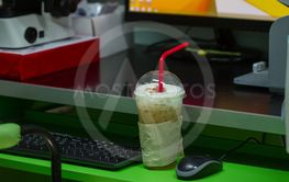iced coffee on table in office background