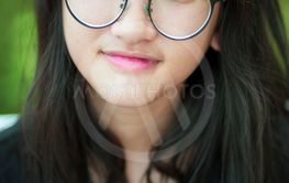 headshot of asian teenager toothy smiling face with...