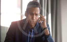 Concerned african American businessman have unpleasant...