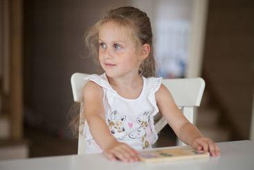 Little cute preschooler child girl playing educational...