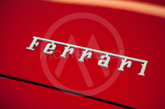 Ferrari brand sign on red sport car in ferrari retailer...