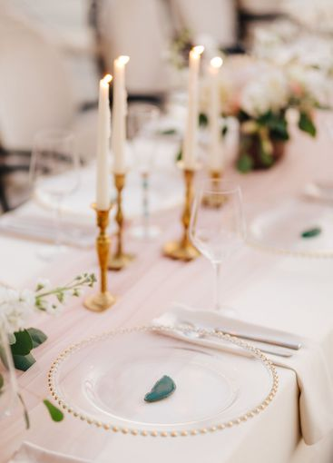 Wedding dinner table reception. Close-up of wildcard...