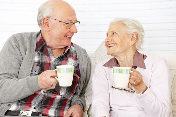 Senior citizen couple drinking coffee