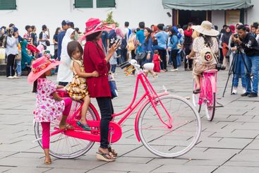 Bicycle and hats rental in the old city of Jakarta,...