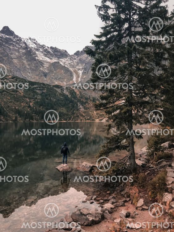 a man stands on the Big Stone in the middle of lake...