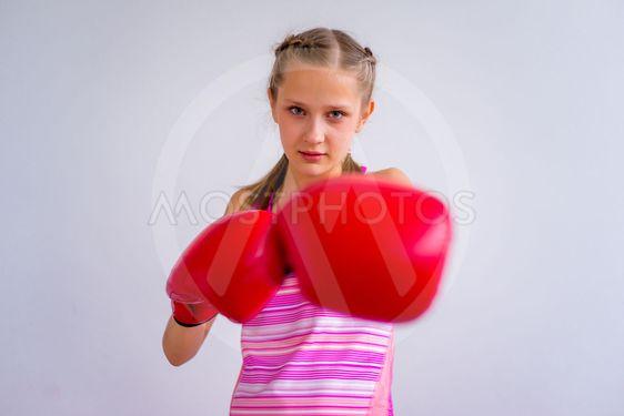 Teen girl boxing