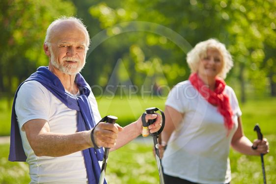 Senior couple hiking together in summer