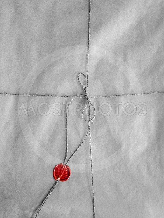 old envelope packed with twine and red seal wax