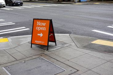 A sign that says the Amazon Go store is now open.