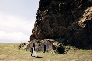 Wedding couple posing at the old houses, covered with...