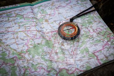 compass and map in the forest