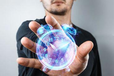Time management concept, A man shows a hologram of a...