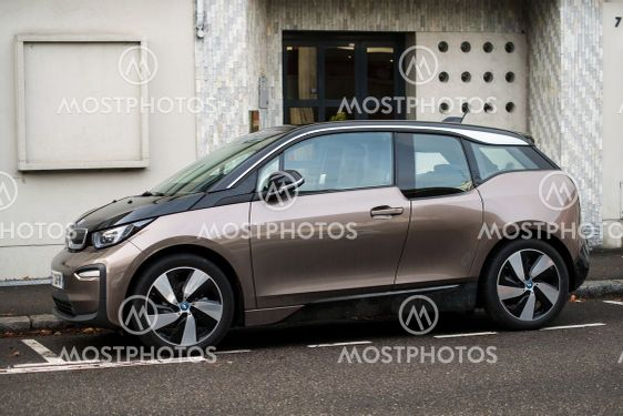 Profile view of brown BMW I3 electric car parked in the...