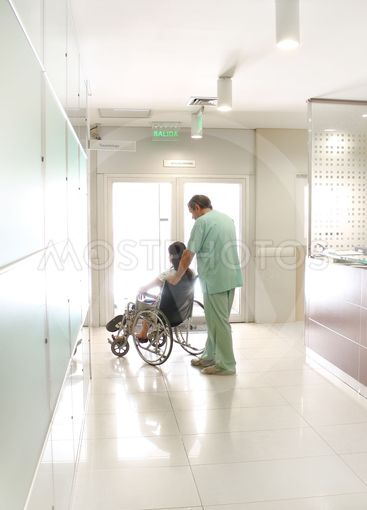 Nurse and a patient using a wheelchair
