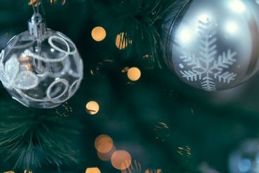 close up of christmas tree ball with lights on
