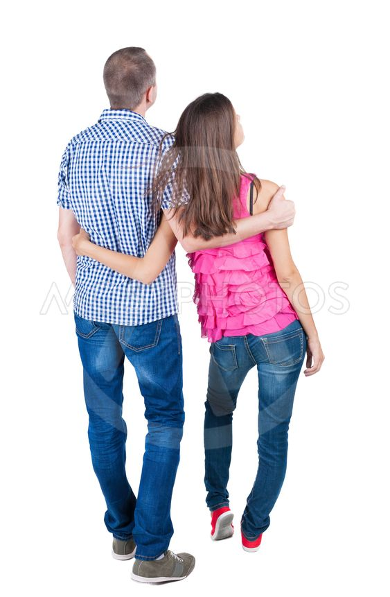 young couple pointing at wal