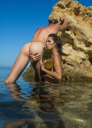 Sexy tanned lady with pineapple and guy with nude...