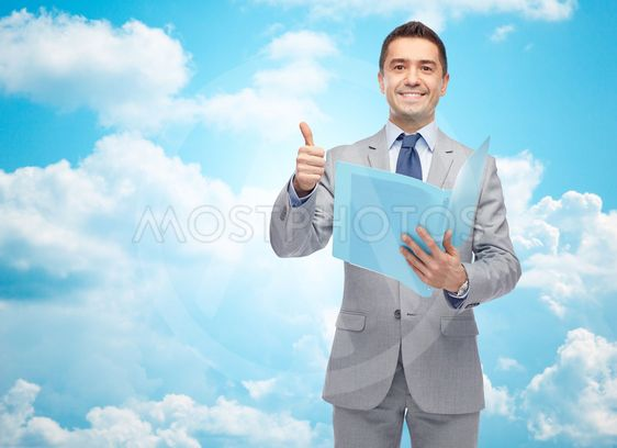 happy businessman with folder showing thumbs up